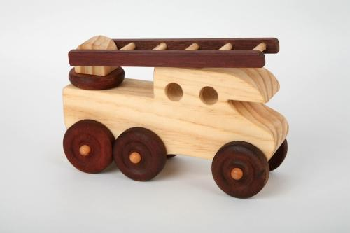 there are three wooden toys in the collection a wooden